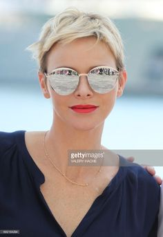 Princess Charlene of Monaco poses after attending the arrival of the first 'Riviera Water Bike Challenge', a water bike race between Nice and Monaco, in Monaco, on June 4, 2017. /