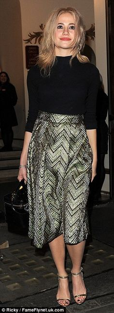 She looks like a lady: The singer looked demure in a zig-zag printed mini skirt and a plain black top