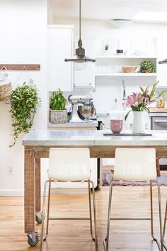 Take a look at these 10 Beautiful White Kitchens   All the White Painted Cabinets Inspiration you'll need to brighten up your kitchen! #whitecabinets #whitekitchens #kitchenideas