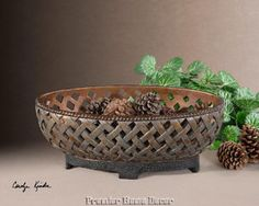 Tuscan decorative bowl features a lattice weave design and has a copper bronze finish with a verdigris glaze and black crackled base. Description from ebay.com. I searched for this on bing.com/images