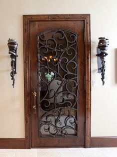 Front door- dark wood, wrought iron and frosted glass (slight arch with wrought iron and glass)