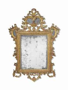 A NORTH ITALIAN GILTWOOD MIRROR -   VENICE, MID-18TH CENTURY -   The rectangular plate within a moulded frame, surmounted by a pierced mirrored scrolled cresting, flanked by C-scrolls and flower heads, with confirming C-scroll apron  77 in. (196 cm.) high; 55 in. (140 cm.) wide