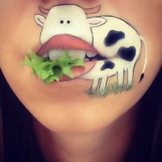A cow munching on lettuce