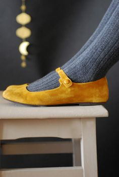 Love. Mustard yellow Mary Janes shoes with grey tights.