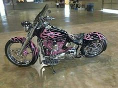 Bad-ass Harley, black with pink flames everywhere. And I mean everywhere! Biker Fiction at www.TraceyCramerKelly.com