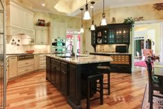 """This Italian inspired kitchen includes unique features such as faux brick painting, a library style """"card catalog"""" recipe storage system and high end cabinetry & appliances.  Designed and built by the Ramage Company."""
