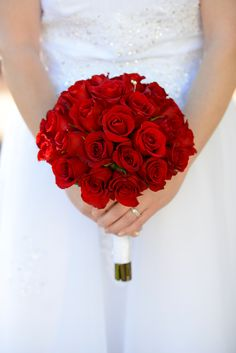 A beautiful bouquet in the color of love for this Disney's Fairy Tale Weddings bride.