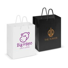 Personalise your gift bags, not only for Christmas but for all year round!  Descriptions: Medium high gloss carry bag made from 157gsm laminated art paper. Colours: White, Black. Dimensions: H 245mm x W 201mm x Gusset 120mm (excludes handles). Screen Print:1 colour, 1 position 150mm x 140mm