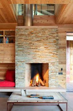 stone fireplace, cedar clad walls, concrete bench