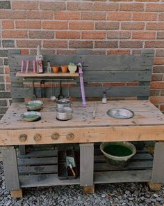 A couple of crates or pallets and some thrifted pots and pans easily become a mud kitchen for outdoor play that will invite your toddler to experiment. Outdoor Learning Spaces, Mud Kitchen, Low Shelves, Programming For Kids, Outdoor Play, Fine Motor Skills, Montessori, Crates, Playroom