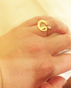 A personal favorite from my Etsy shop https://www.etsy.com/listing/179940379/arabic-vav-letter-gold-ringislamicgold