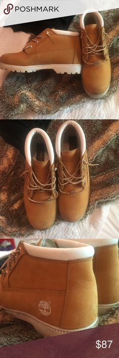 Women's ankle cut timberlands Customized white leather rim and sole. Almost perfect condition. Worn three times. Looks like  Kendall jenners Tims. Size ten but I'm a nine Timberland Shoes Combat & Moto Boots