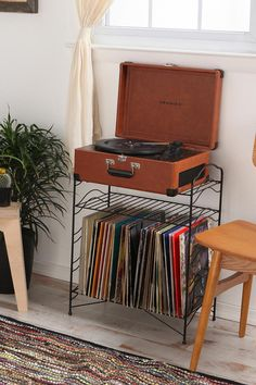 I miss being able to listen to my records.   I have no place for my player in my room.  This would solve everything