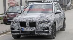 Next BMW X5 spied with production-spec headlights and grille
