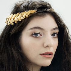 Lorde wearing a wreath head we custom made for her US tour.
