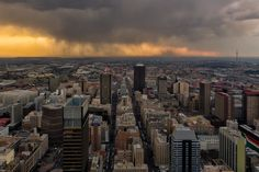 """The rain cometh"" has been published on Pascal Parent Photos  More information at http://wp.me/p4WBG2-mm It is Saturday evening and a few photographers have come together on the 50th floor of the Carlton Center and the weather is not playing nice. Once a renowned and hip tourist attraction the ""Top of Africa"" is now a desert of derelict shops and restaurants. It still holds one unique aspect, it is the highest publicly accessible point of Johannesburg City Cente"