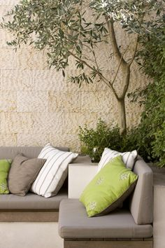 the sandstone wall is the perfect background to a relaxed courtyard lifestyle
