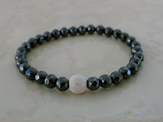 Everyday Bling.Diamond Faceted Hematite with Sterling Stardust Bead.