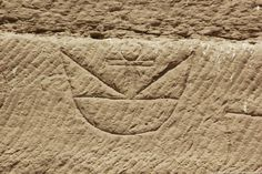 """The 'ankh hieroglyph (life) rising between two """"horns"""" at the quarries of Gebel el Silsilah. Image from this site . See also a photo here"""