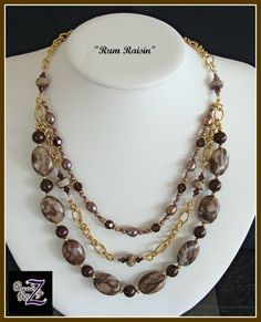 """Mocha, burgundy and gold triple strand. Gold accents and chain are gold plated brass. Necklace strands fall from 19"""" to 23"""" $60 Sold but similar to """"Fashion"""""""