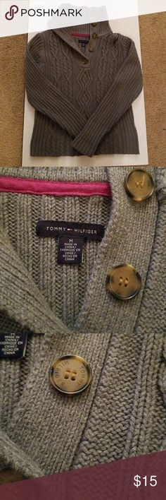 Tommy hilfiger sweater size M Button up turtle neck sweater. Cable knit front. Ribbed sleeves and back. Two snags on the neck . One is on the back. One is on the front. Shown in last two pics. Really good shape though Tommy Hilfiger Sweaters Cowl & Turtlenecks