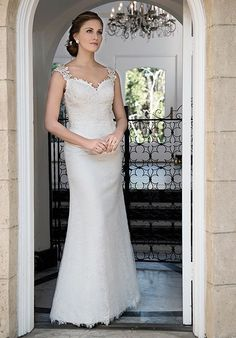 All over lace dress with sweetheart neckline and straps decorated with same beaded appliques. Illusion back finished with beaded appliques and Zipper.