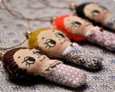 embroidered fabric doll necklaces