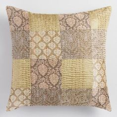 Showcasing a soft patchwork of earth-toned patterns, our throw pillow from India brings rich global style to your space with its classic Gudari inspiration.