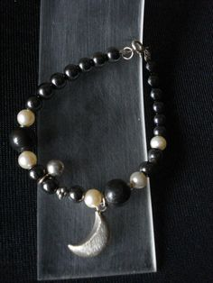 Hand made bracelet of silver 925,pearls and onyx.Made by Eirini Svarnia Price 35,00 euro