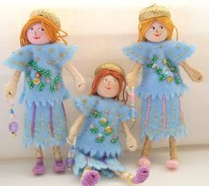 Our Blue Skies lady piksee is a two hanging doll ornaments and is ready for Easter and spring. Our Piksees are handcrafted with the finest