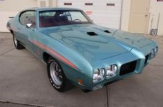 1970 Pontiac GTO Judge - 1 of only 1 in Mint Turquoise with Orange, Blue & Pink Stripes and a Red Interior. For sale in Calgary, Alberta.