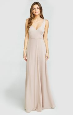 Jen Maxi can elegantly twirl and spin all night long. Her deep neckline lets you play around with your necklace length - or go without and rock some amazing earrings!  Hair up, hair down, this neckline lets you pull anything look off.     *MADE IN THE GORGE USA* *I Come in Five Sizes:  XS, S, M, L, XL *100% Poly  *Fitted Bodice *Zipper in back  *Detachable sash  *Mumu Bridesmaid dresses are standard 'long' bridesmaid length. They will fit most heights and heels…