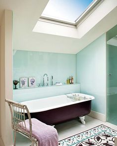 Beautiful attic bathroom, Sky light and tiles simulating a rug.