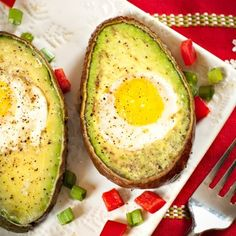 """Avocado Egg Boats: I'm literally eating this as I pin! So delicious & creamy! I baked them for 10 min at 425, and made a little foil """"stand"""" to hold them up. I also put bacon in mine :) #omnomnom"""