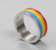 Item Description - Gender: Unisex - Material: Metal - Occasion: Party - Metals Type: Stainless Steel - Shapepattern: Geometric - Design: Rainbow striped ring Shipping & Handling This Item is eligible