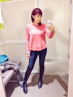 Bright pink sweaters, blue jeans and over knee boots