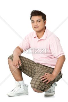 image of a young male posing against white background. - Portrait shot of a young man in casual wear posing against white background. Model: Reynaldo B. Sucgang Jr.