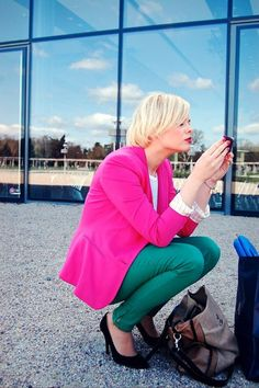pink blazer and green jeans