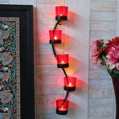 Shaz Living Charming Votive Candle Holder Wall Decor - Decorate your patio area with this red coloured wall mounted candle holder. Innovative and attractive, this stunning candle holder will add instant style to the overall setting. It can hold upto five candles at a time.