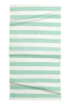 Striped cotton rug: Rectangular cotton rug with print stripes and anti-slip protectors on the back.