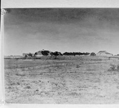 Karl Questad Farm, near Cranfills Gap, Bosque County, Texas. Pasture in foreground, with farm structures in distance. Photo taken in mid to late 1800s.
