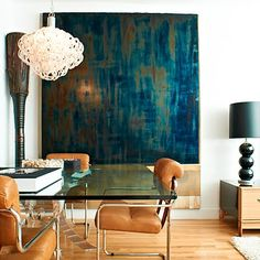 Leather chairs, huge blue artwork. Jason Carroll's dining room