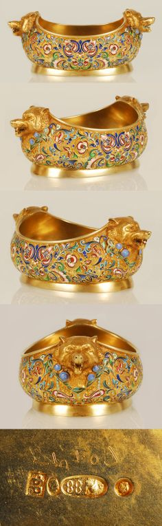 A Russian gilded silver and shaded cloisonne enamel bowl by Feodor Ruckert, Moscow, circa 1908-1917. Of oval form with figural silver-gilt handles in the form of bear heads, the body decorated with shaded florals against gilded grounds.