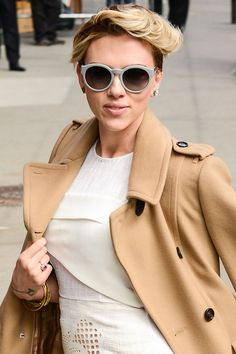 Who: Scarlett Johansson What: A Retro Swoop : Grey sunglasses How-To: The actress looked the part of a modern Hitchcock blonde as she entered The Late Show with David Letterman yesterday, showing just how feminine an ultrashort pixie cut can be. Work styling paste into hair, then fasten sections back into loose, deconstructed pin curls. Editor's Pick: Dolce & Gabbana The Classic Cream Lipstick in Nude, $33.50, sephora.com.   - HarpersBAZAAR.com