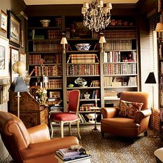 Stained wood library built ins; blue velvet Chesterfield sofa. Description from pinterest.com. I searched for this on bing.com/images