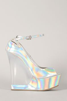 Look amazingly hot in these holographic wedges! Featuring open toe front, cut out details, wrapped platform, and lucite wedge heel. Finished with lightly padded insole and adjustable ankle strap with buckle closure.