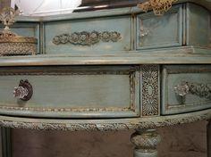Grayed turquoise with umber antique glazing.