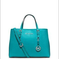 "Michael Kors jet set medium tote JET SET MEDIUM SAFFIANO LEATHER TOTE-TURQUOISE -Top Handle: 5""  -Adjustable Strap: 20-22""  -Interior: One Zip Divider Pocket, One Zip Pocket, Three Open Pockets, One Cell Phone Pocket, One Key Fob  -12 X 9 X 5  -Dog Clip -100% Polyester Lining.  ❌NO TRADES❌ Michael Kors Bags Totes"