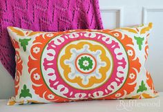 colorful pillow colorful!! #spring is here Put the spring back into your home #accessorize #colored pillows http://jacarandaliving.com/blog/7-tips-to-put-the-spring-into-your-home/
