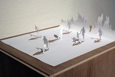 A4 Papercut series by Peter Callesen shows the tragedy of the now 3D figures still being bound to their 2D paper world
